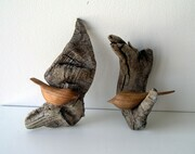 Stylized birds mounted on driftwood